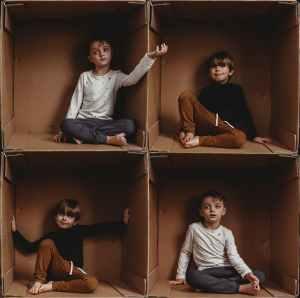 photo of boys sitting on box