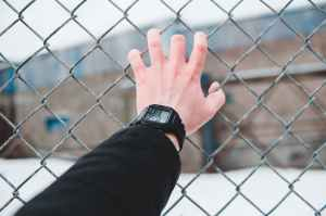 person wearing black digital watch